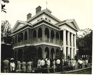 People lined up waiting for the Haunted Mansion at Disneyland